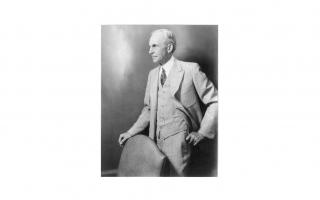 Black and white photograph of Henry Ford standing